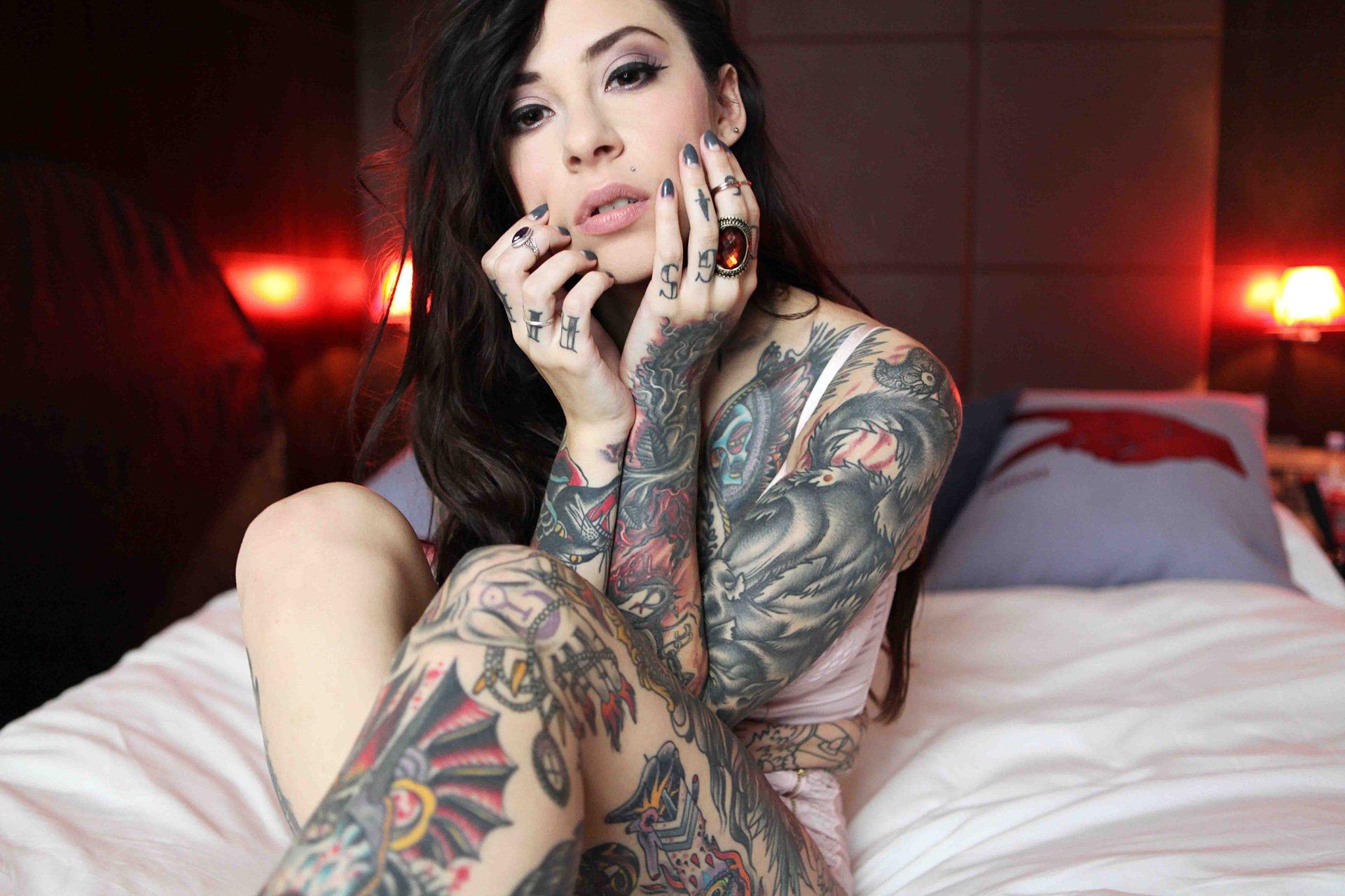 tattooed brunette in black fishnet is eating jizz with appetite  141107